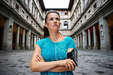 Fitness young woman is staying in front of Uffizi gallery