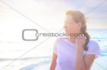 Portrait of young woman at the beach