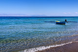 Small boat near the shore on the mediterranean sea