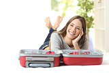 Happy woman planning a travel