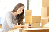 Woman packing or unpacking moving home
