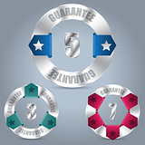 Metallic guarantee badge set with color ribbons