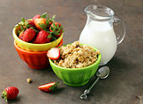 healthy breakfast of muesli, yoghurt, chia seeds, fruit and goji