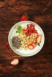 healthy breakfast of muesli, yoghurt, chia seeds, fruit and goji