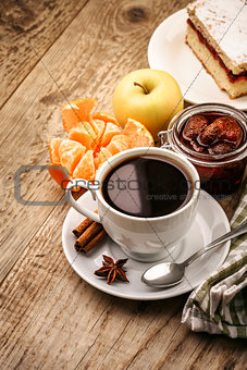 Breakfast with coffee and fruits