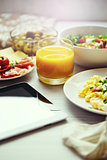 Fresh breakfast food. Scrambled eggs and juice.