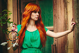 Creative Portrait of Redhead Woman in Green Dress