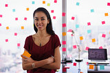 Portrait Business Woman Writing Sticky Notes Smiling At Camera