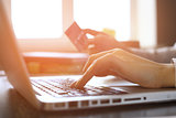 Close Up Of A woman Shopping Online Using Laptop With Credit Card