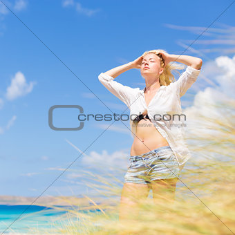 Free Happy Woman Enjoying Sun on Vacations.