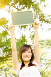 Asian college girl student with blank chalkboard