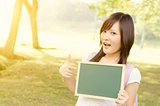 Asian female college student with blank chalkboard