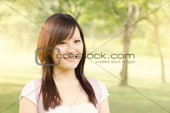 Asian college girl student smiling