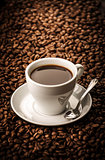 Black coffee on beans background