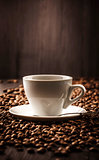 Cup of coffee on beans background