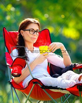 Beautiful woman resting outdoors