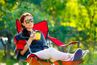 Beautiful woman resting outdoors