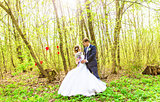 Bride and groom having a romantic moment on their wedding day outdoor