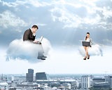 Business people working on clouds