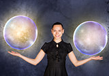 Businesswoman holding two big bubbles
