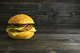 The concept of fast food. Burger on a wooden board. White background