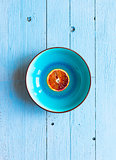 Colorful Orange fruits over a light blue painted wood table