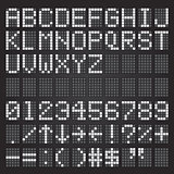Set of white letters on a mechanical timetable, airport symbols