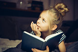 Girl reading a book and dreams