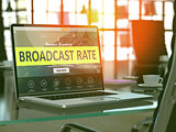 Laptop Screen with Broadcast Rate Concept.