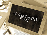 Development Plan Handwritten by White Chalk on a Blackboard.