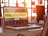 Laptop Screen with Brand Development Concept.