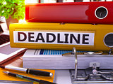 Yellow Ring Binder with Inscription Deadline.