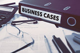 Business Cases on Ring Binder. Blured, Toned Image.