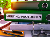 Meeting Protocols on Green Ring Binder. Blurred, Toned Image.