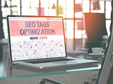 SEO Tags Optimization - Concept on Laptop Screen.