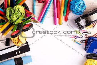 Office supplies on wooden desk