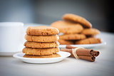 Fresh baked peanut butter cookies with cinamon sticks