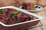 Gingerbread cake with mulberries and red currants