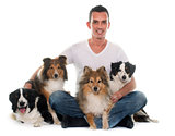 four beautiful dogs and man