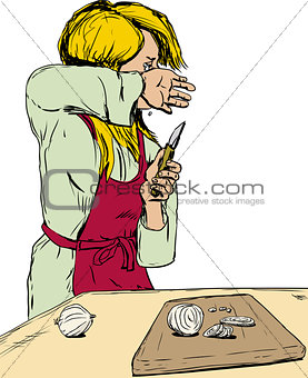 Blond woman crying as she cuts onions