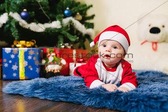 Baby dressed in Santa Claus