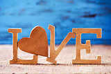 wooden heart and letters forming the word love