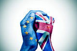 hands patterned with the European and the British flag put toget