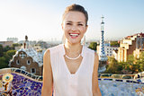 Smiling young woman tourist in Park Guell, Barcelona, Spain