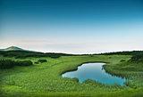 Morning near small mountainous pond