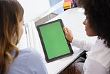 Women Architect Using Tablet PC With Green Screen