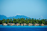 Overwater bungalows with view of amazing blue lagoon