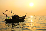 Silhouette of fishing boat at sunset