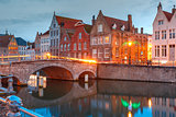 Night Bruges canal and bridge, Belgium
