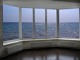big office windows with view of marine waves